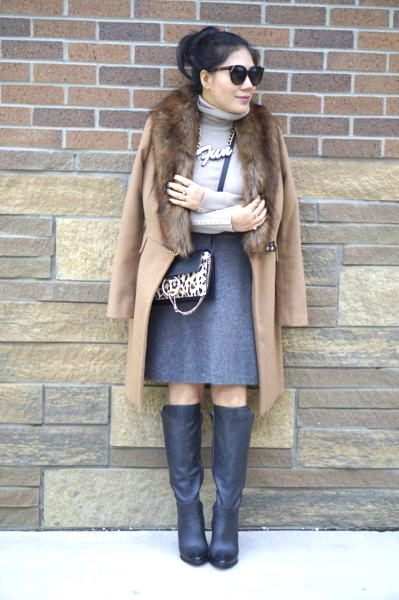 grace in denim skirt, boots and camel coat with fur collar