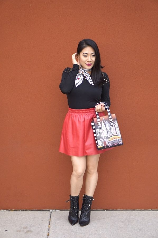 grace-in-a-red-skirt-and-black-top-and-boots
