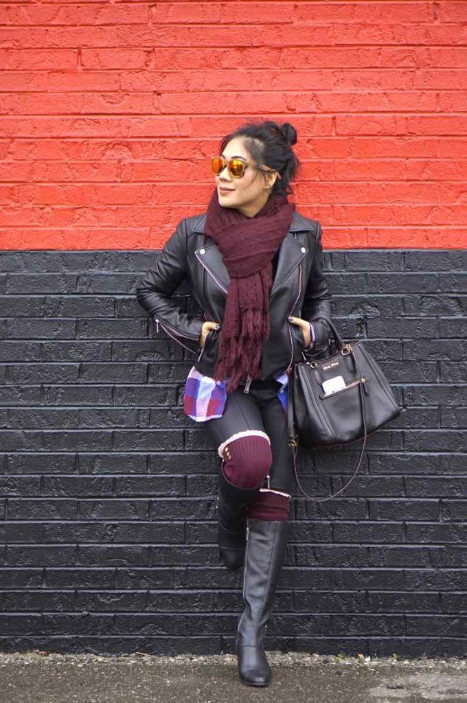 Motorcycle leather jacket with burgundy scarf, leggings, and black boots