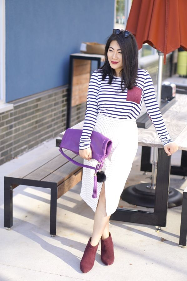 Grace-in-striped-shirt-with-ribbed-white-assymetric-skirt-and-burgundy-shoes